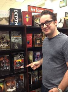 The anthologist (and his anthology) in the wild. Photo credit: Miranda Afsharirad.